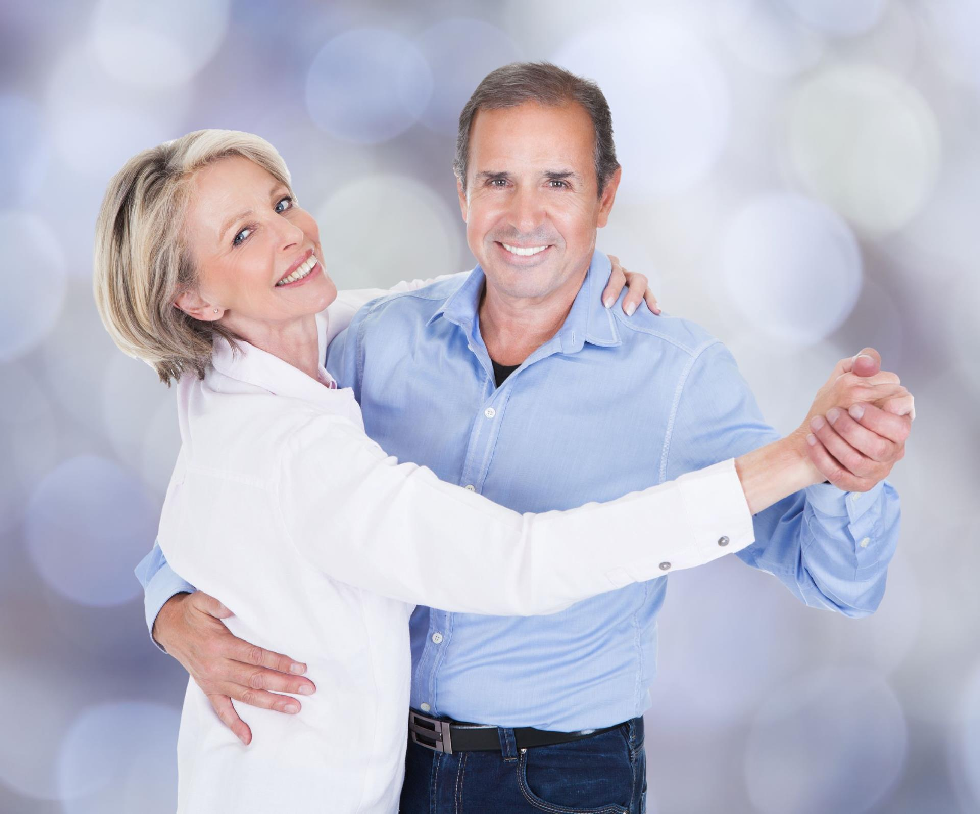 Dancing couple on blue background