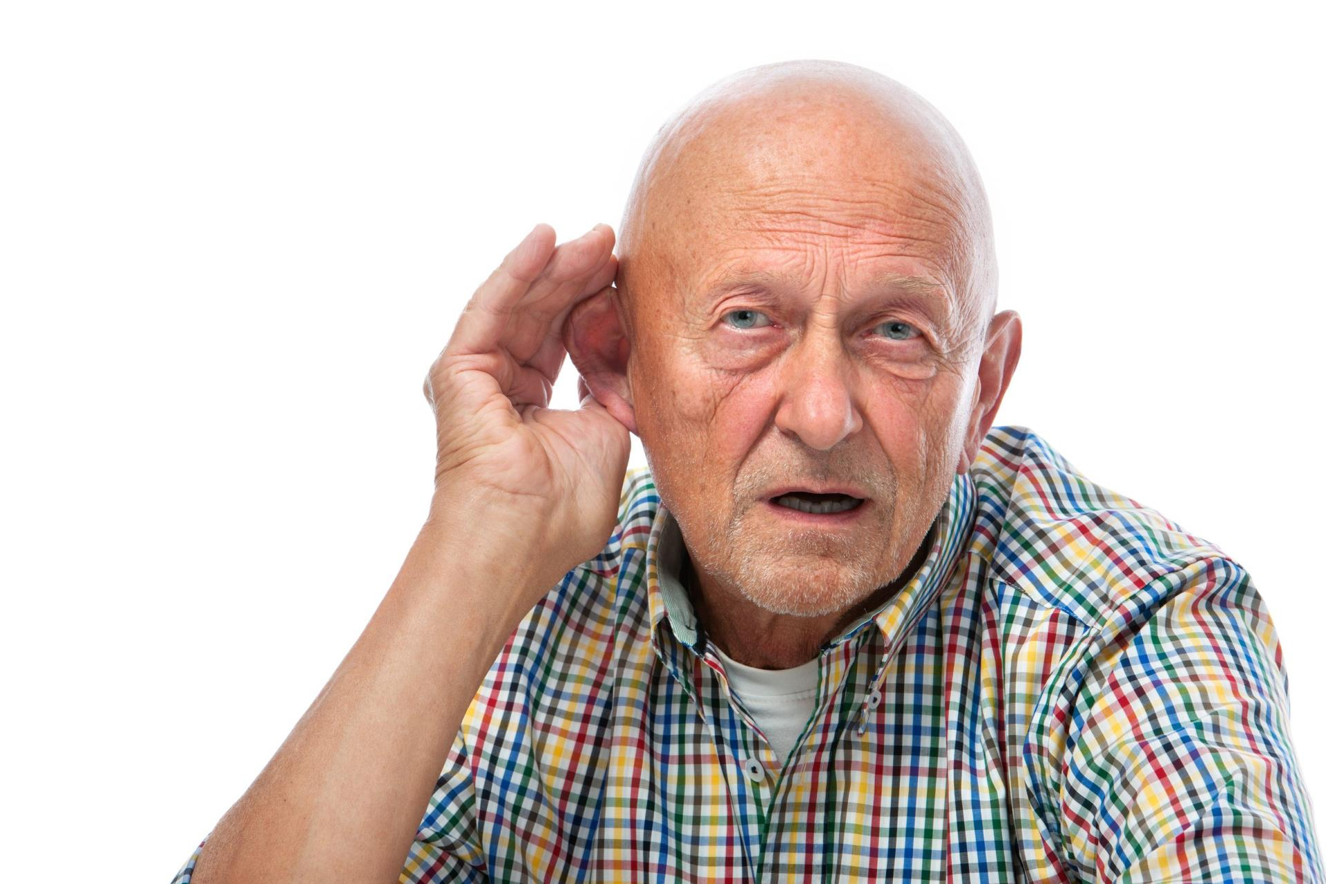 Man w hand cupped over ear