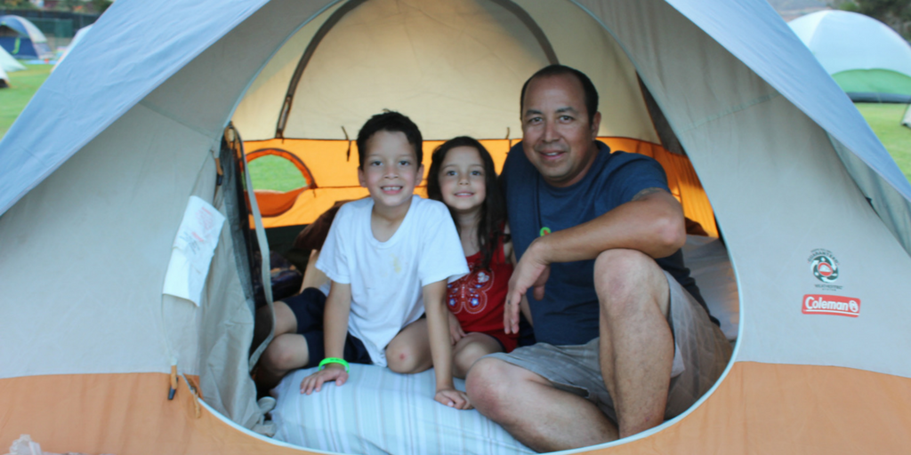 Family sets ups their tent at the San Marcos Family Campout