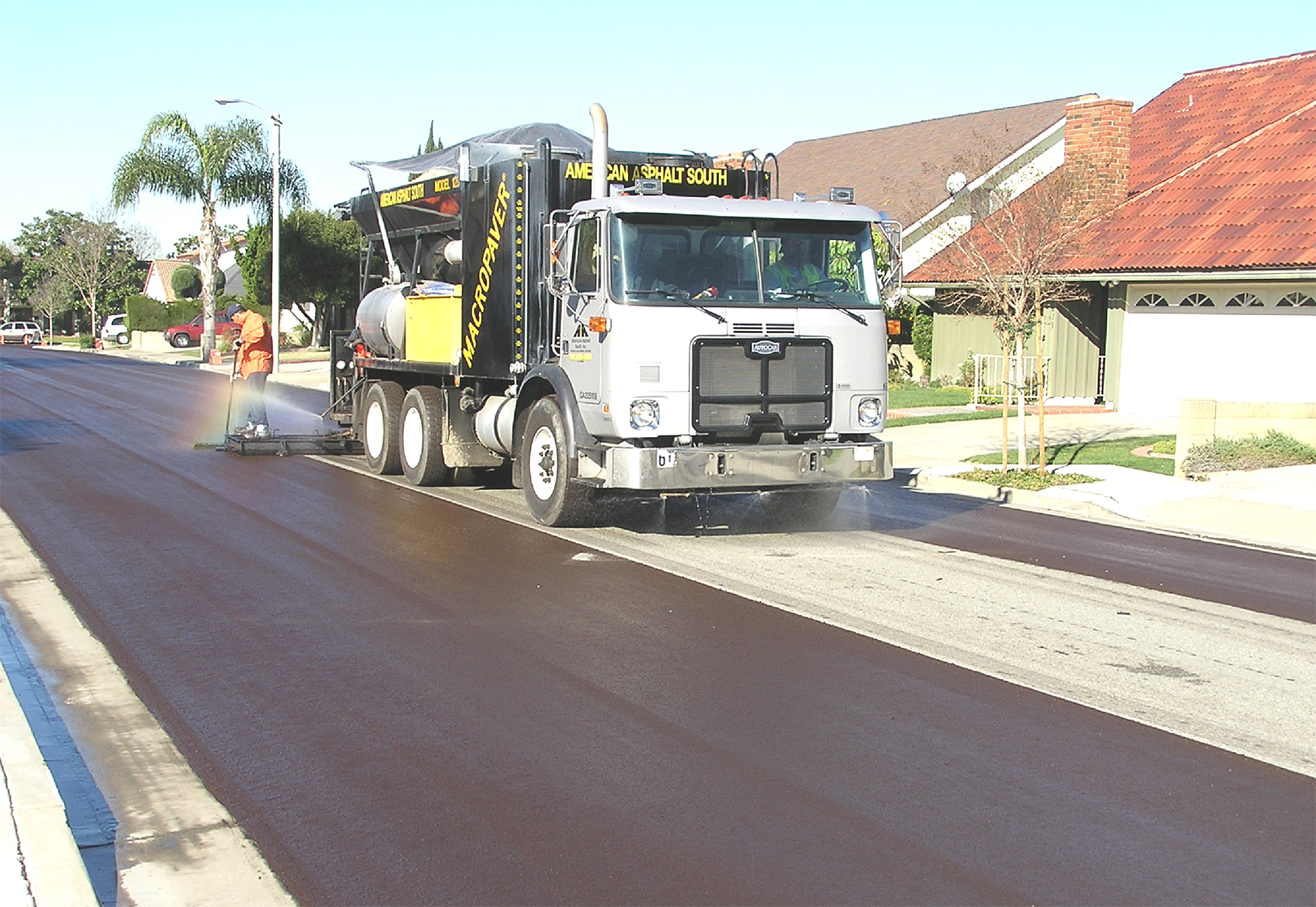 Slurry seal being applied to a street